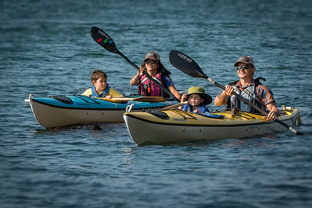 Family kayaking in Deception Pass
